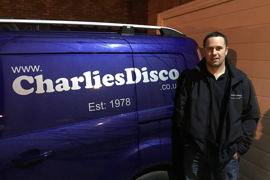 DJ Barry standing next to Charlie's Disco van